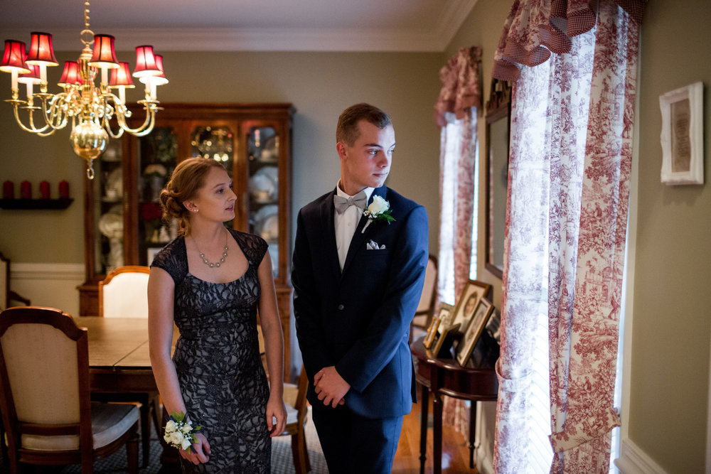 Sean Hardy, 17, a senior at Facquier Highschool, with his girlfriend, Lexi, at her home before prom in Warrenton, Virginia, 22 April 2017. Sean is a top shooter with his shooting team sponsored by their local American Legion. He is heading to Coastal Carolina University, and hopes to join the Navy.