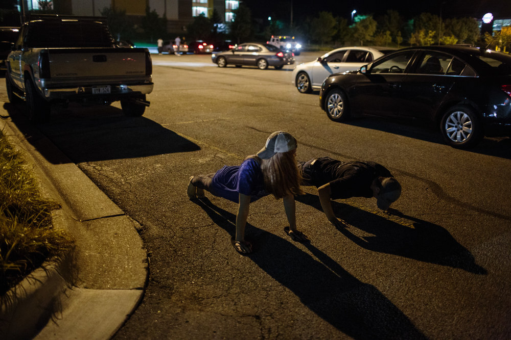 Elizabeth Nelson, 17, challenges a love interest of her best friend to a push up contest in the parking lot of Home Depot, 25 August 2017, Omaha, Nebraska. Elizabeth's interest in the army began from attending Civil Air Patrol classes and encampments.