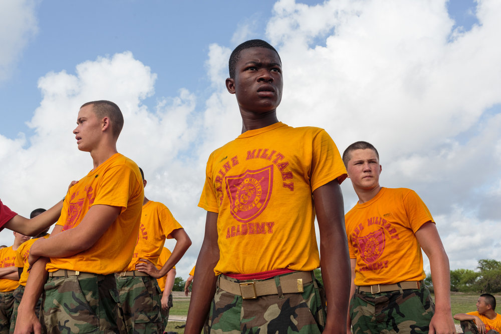 Students prepare to begin an afternoon of physical drills at Marine Military Academy, an all-boys institution. MMA hosts a summer camp on their academic campus in Harlingen, Texas, 17 July 2017. The camp hosts boys from around the world, ages 12-18, with around 300 cadets in attendance.