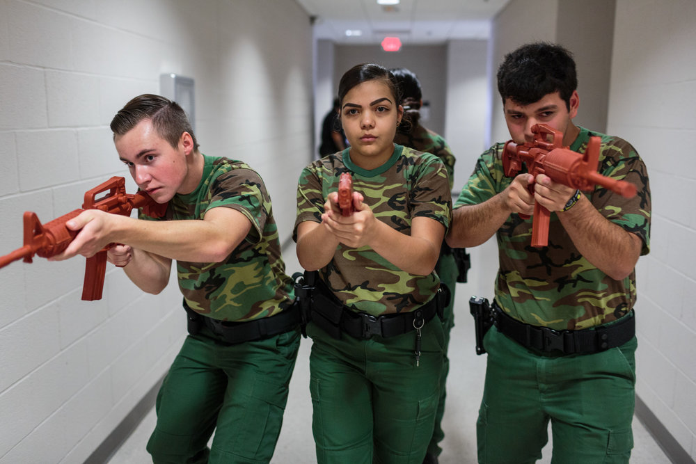 Ryan Dunlavy (L), Nerisa Garcia (M), Jeremy Cabral (R), students from the Border Patrol Explorer Program, practice active shooter scenarios and room clearing at the United States Border Patrol Station in Kingsville Texas Station, 19 July 2017. The Explorer program is sponsored by Boy Scouts and Homeland Security, and nearly 700 students, ages 14-20, participate at their local Border Patrol post.