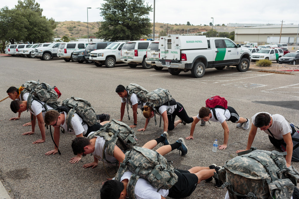"On the third day of an Academy Week, students from the Border Patrol Explorer program train in drills in the parking lot of their local Border Patrol Post 125, Nogales, AZ, 1 June 2017. The ""Explorer"" program offers 14-20 year olds the opportunity to work with law enforcement and experience what it is like to work as a border patrol agent."