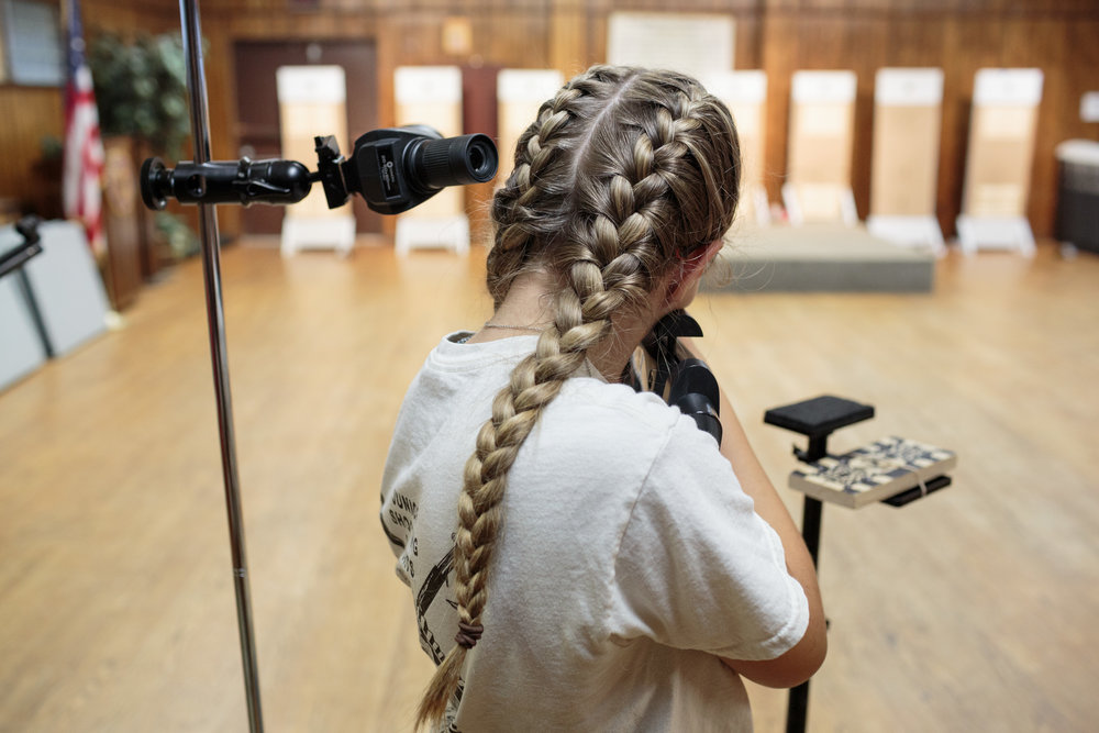 Ryan, a student from the Warrenton Rifle Junior Shooter team, practices at her local American Legion post 72, Warrenton, Virginia, 20 April 2017. The students are preparing for a regional competition this coming Sunday.