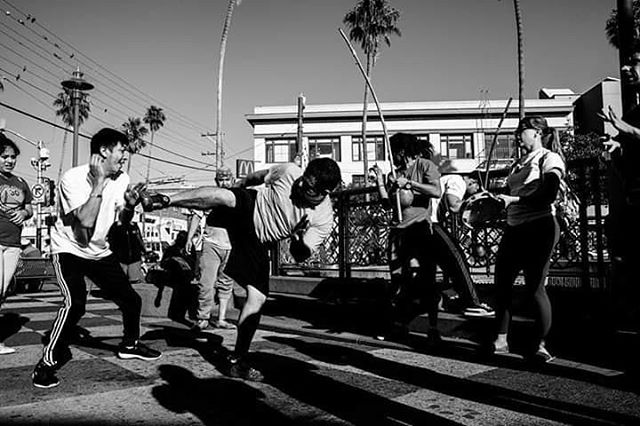 A bunch of people dancing and practicing Capoeira on 16th st.  Photo by @rastadave52