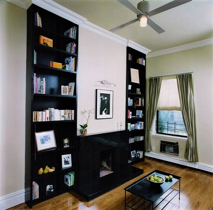 living room with custom bookshelves and slate fireplace