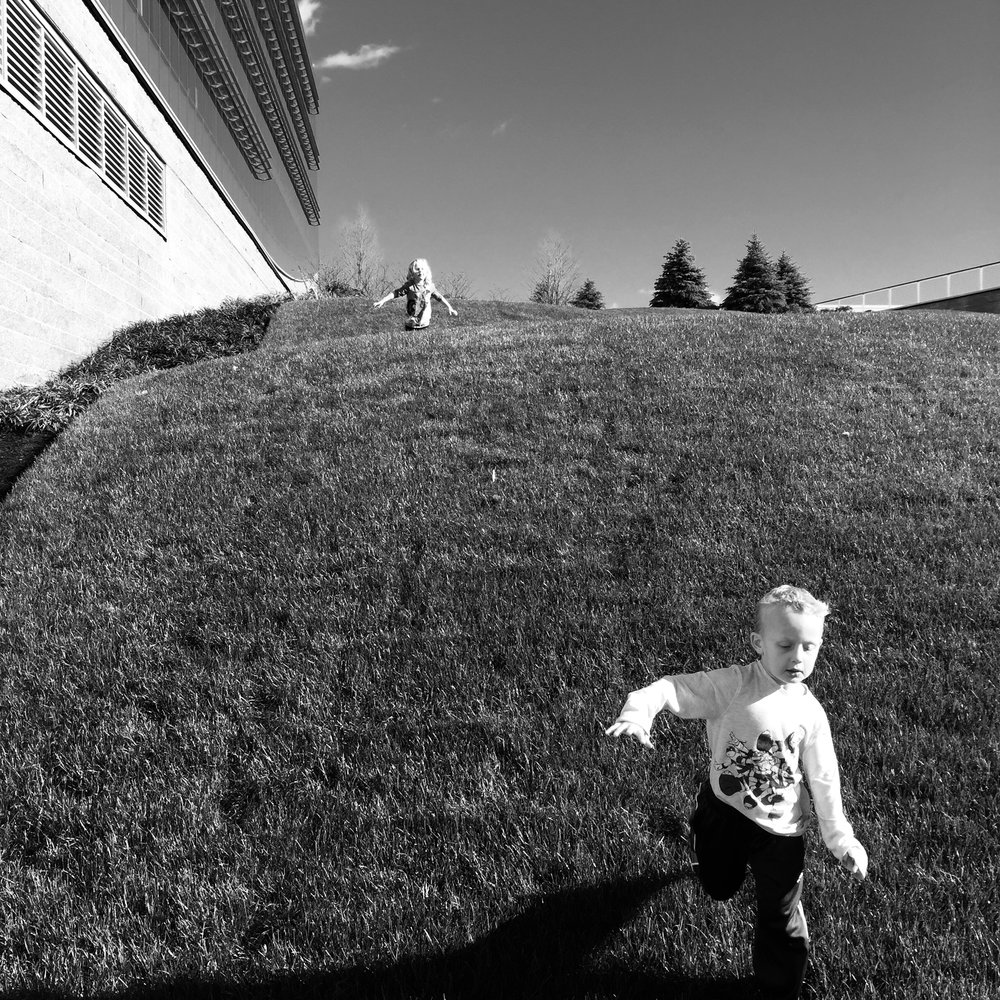 My twin boy running down the hill. His twin sister fell 10 seconds later and we went to the ER.
