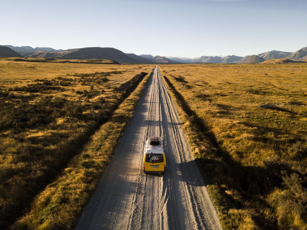 Campervan hire Christchurch. Mad Camper driving down road. jpg.jpg