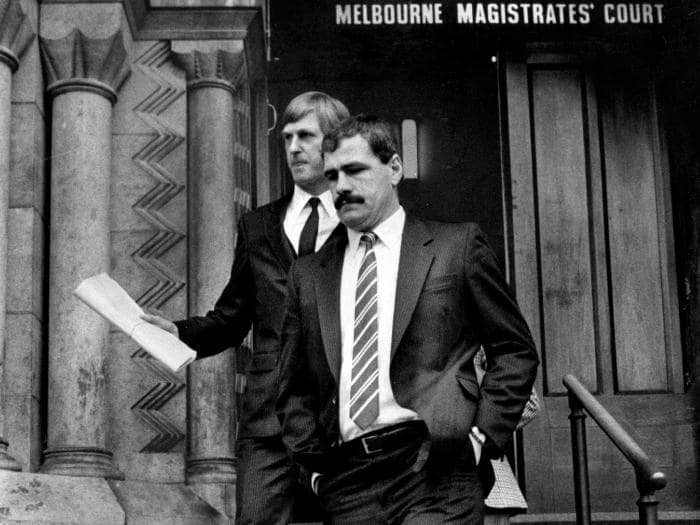 ABOVE: Hawthorn VFL player Leigh Matthews leaves Melbourne Magistrates' Court after being fined for assaulting Geelong's Neville Bruns during a VFL match at Princes Park in 1985.