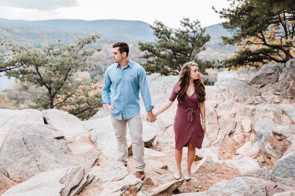 couple at the top of weverton cliffs in west virginia - maryland engagement photographer