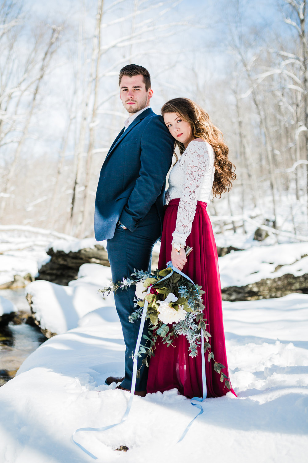 couple posing during their snowy engagement session in carroll county maryland