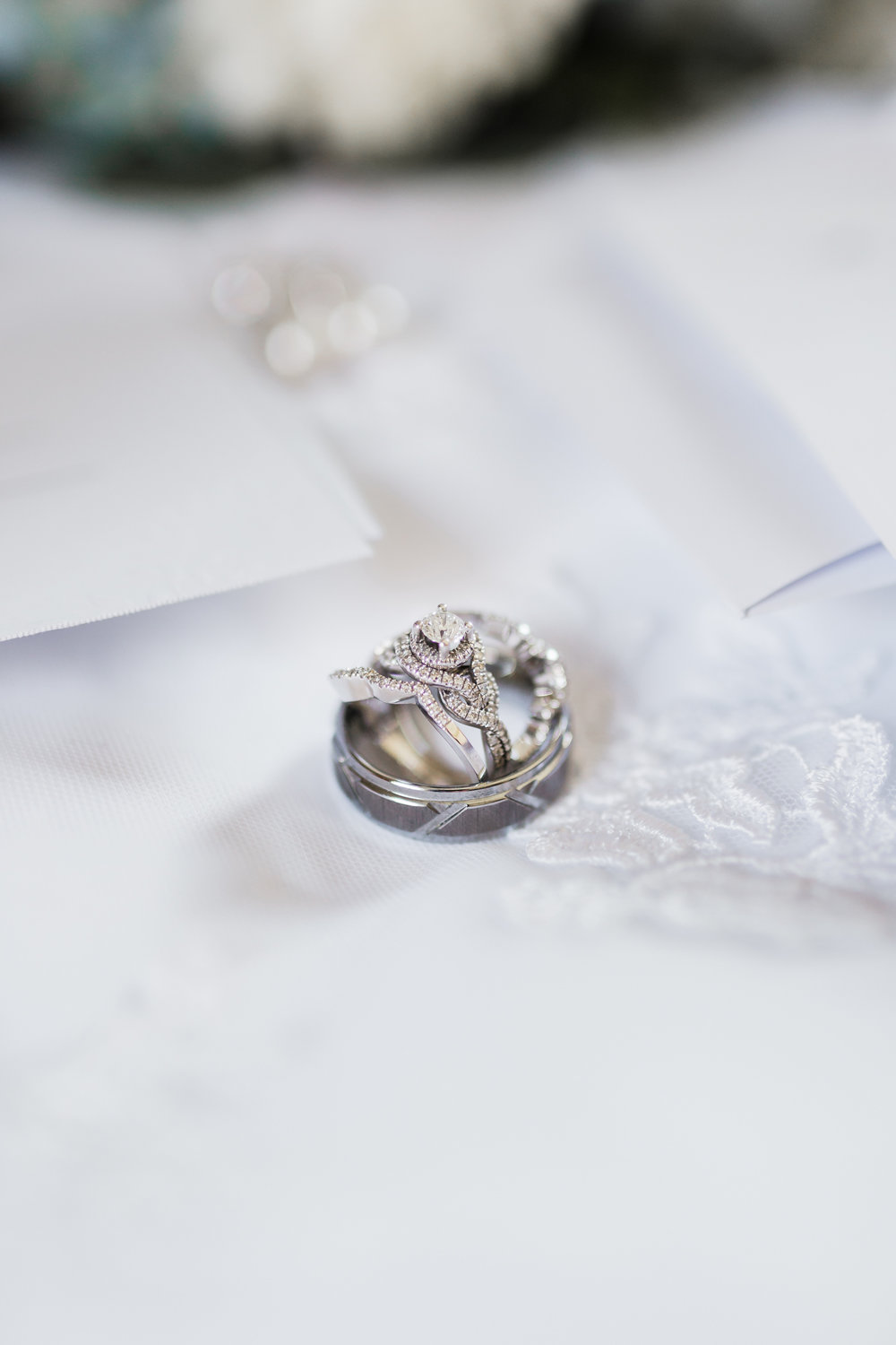 Bridal details of bride and  groom wedding rings