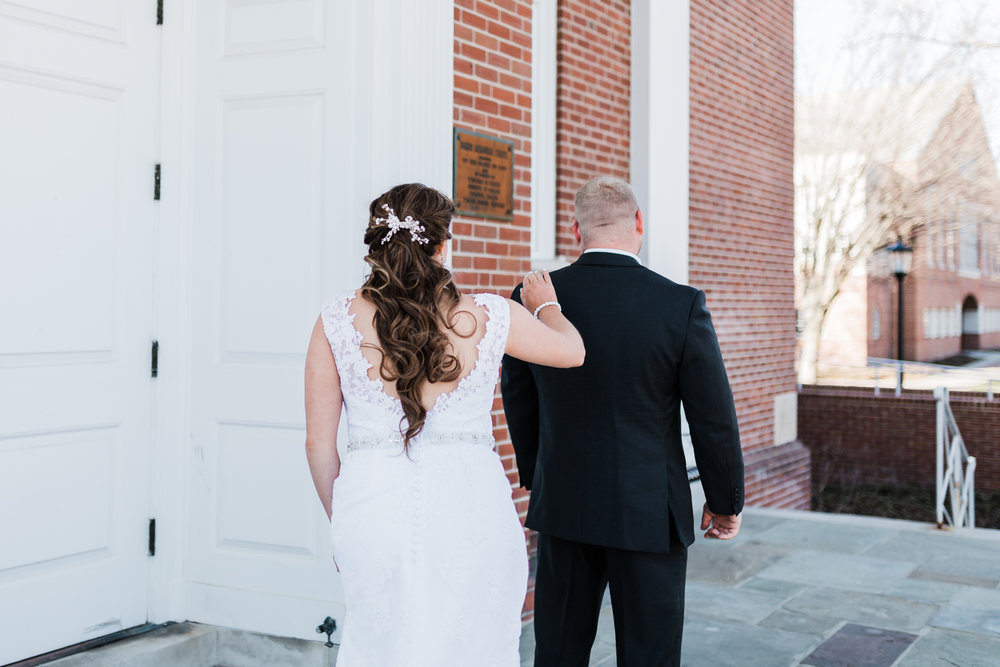 Bride and groom have their first look on the steps at McDaniel College