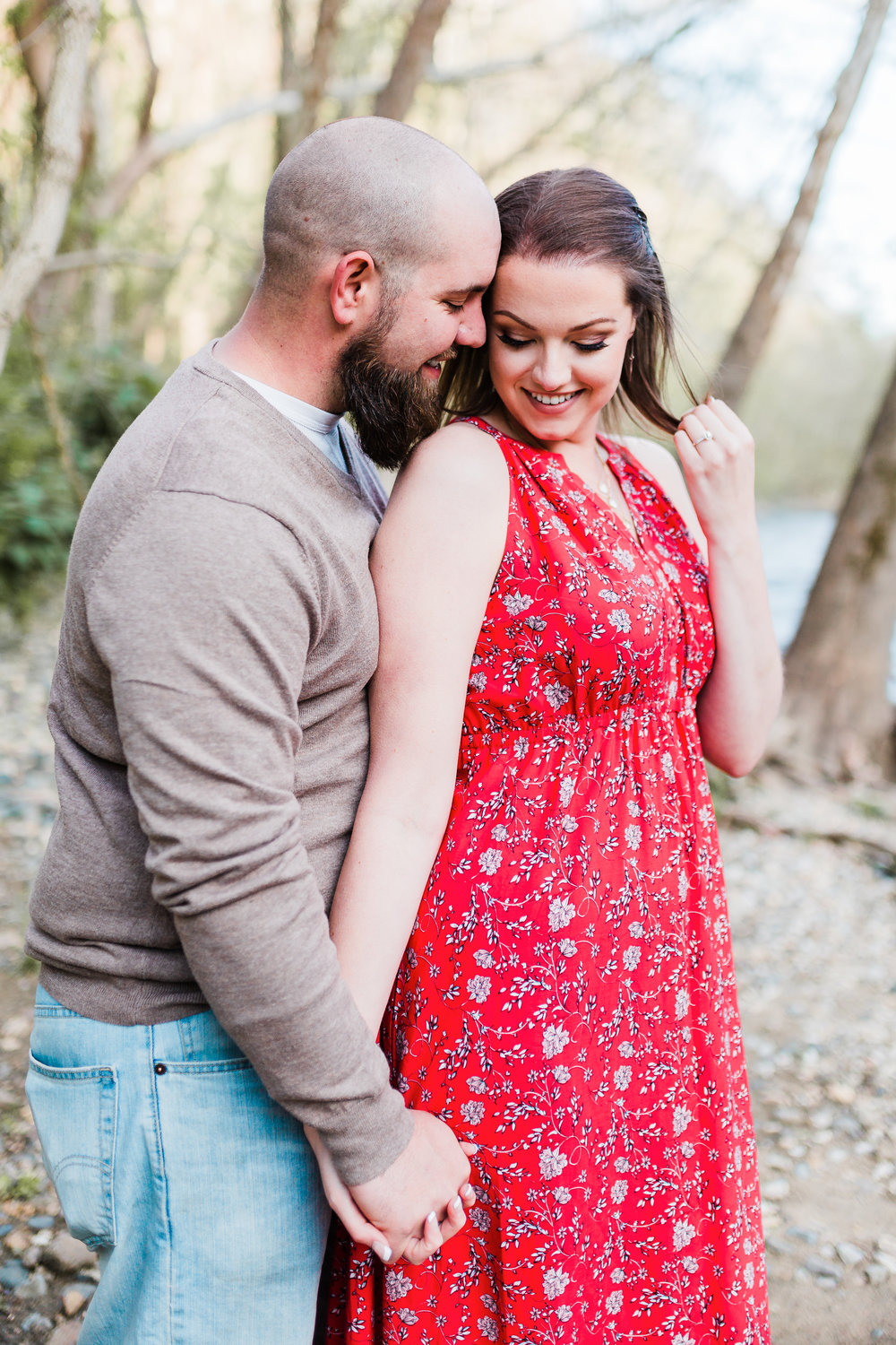 bride and groom pose together while laughing in maryland