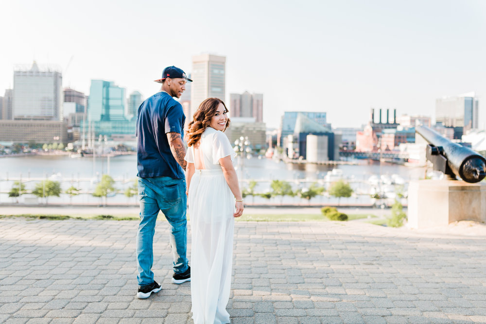 couple walking at the top of federal hill in baltimore, maryland