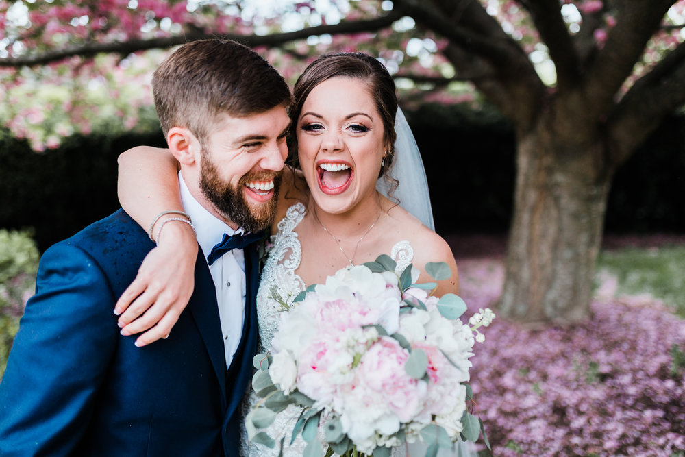 bride with her brother laughing at maryland wedding - photographer