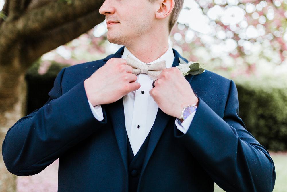 groom adjusting bowtie