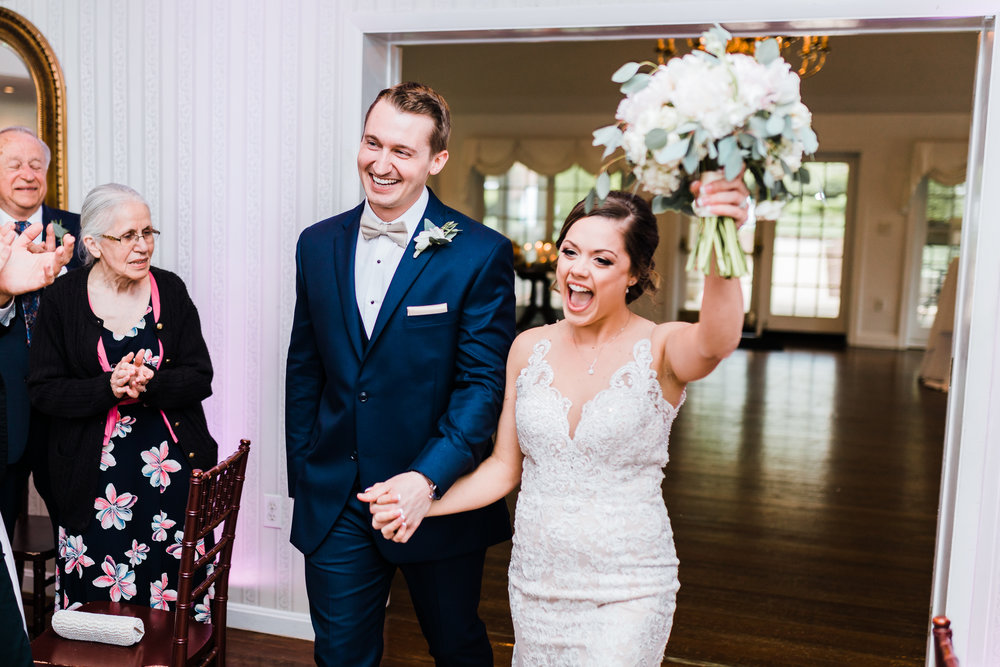 bride and groom excited to come in to their wedding at antrim 1844 - maryland wedding photography