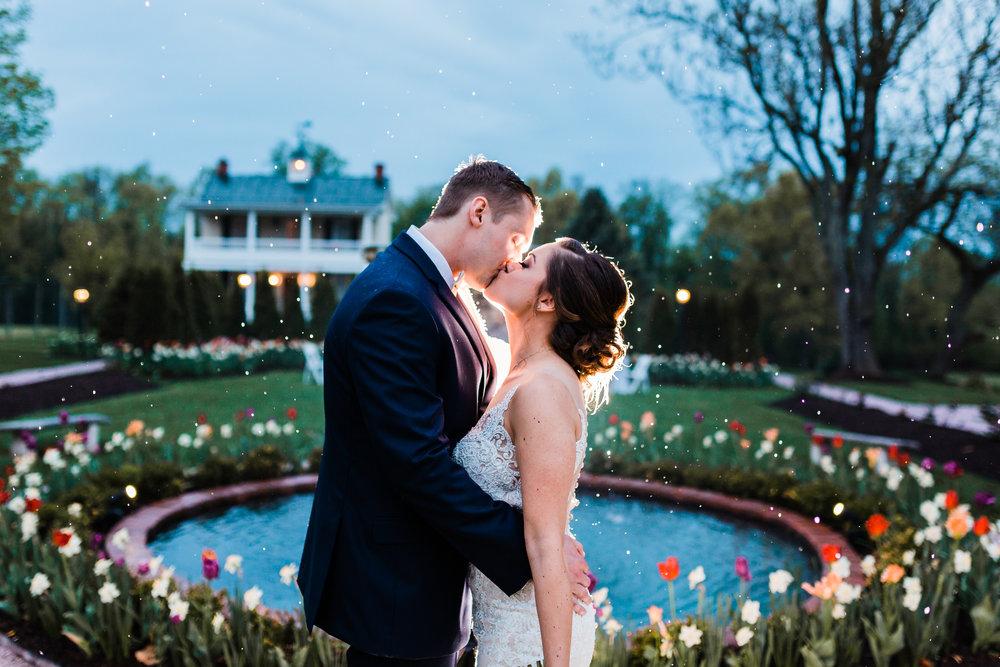 rainy wedding night bride and groom portrait