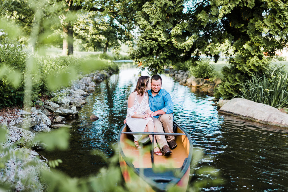 couple snuggling in a canoe at md engagement session