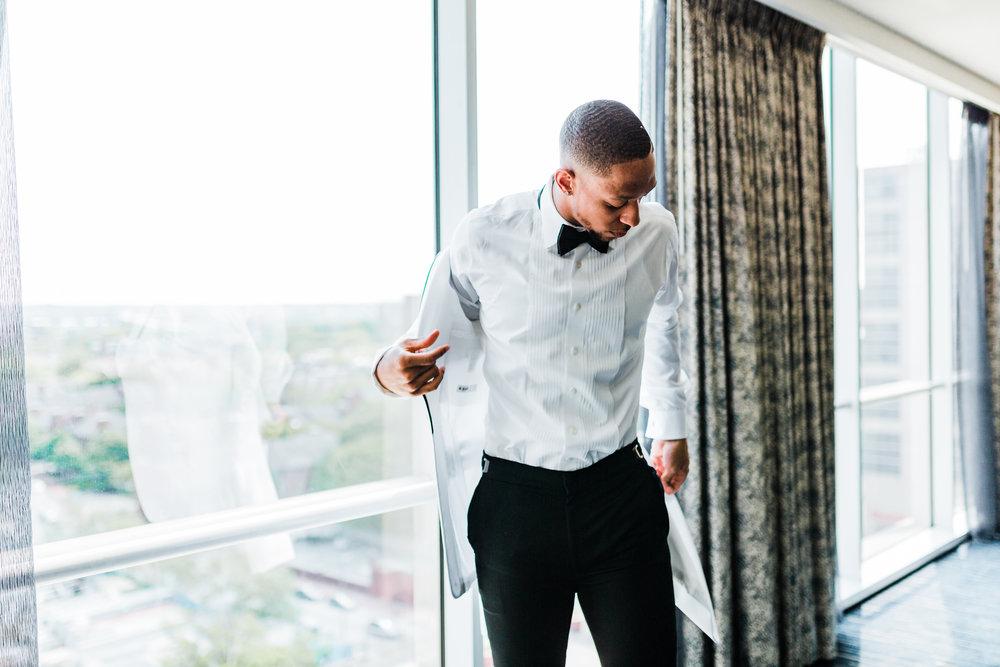 groom getting ready at Hyatt Regency - Baltimore wedding photographer