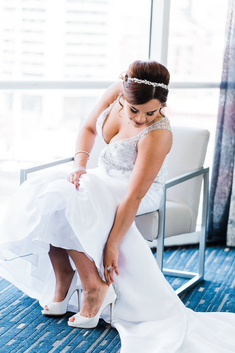 bride putting on her shoes in downtown baltimore