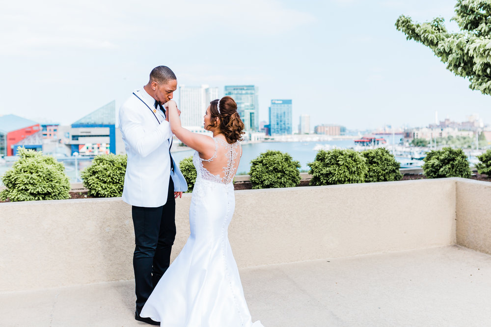 groom kissing his bride's hand in baltimore maryland
