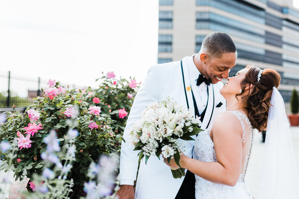 baltimore couple snuggling on their wedding day