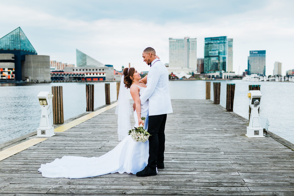 beautiful bride and groom at the harbor in baltimore md
