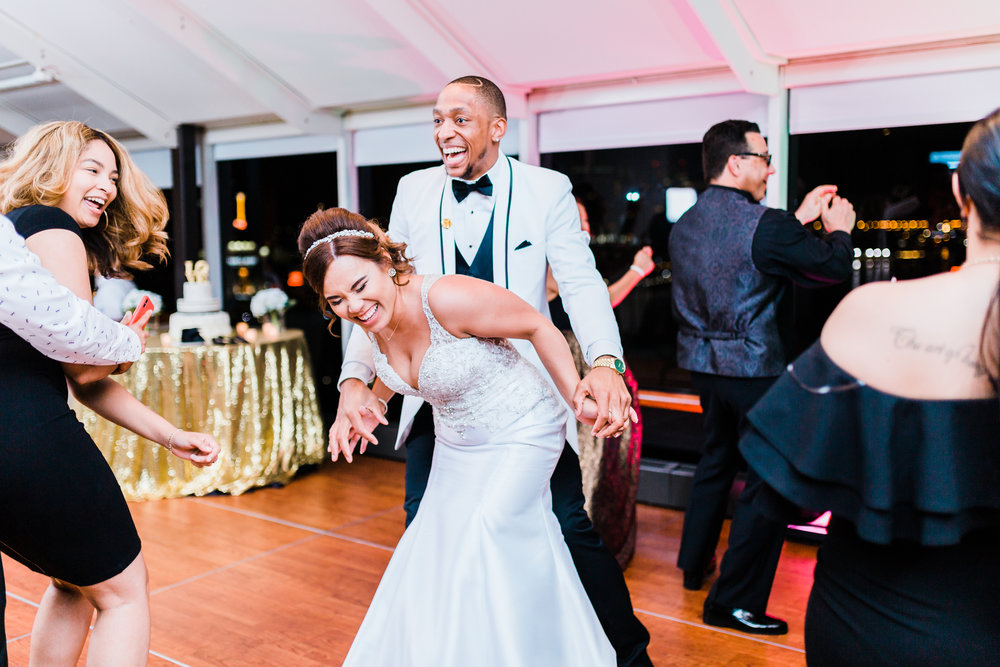 bride and groom laughing together as they dance - md wedding photo and video