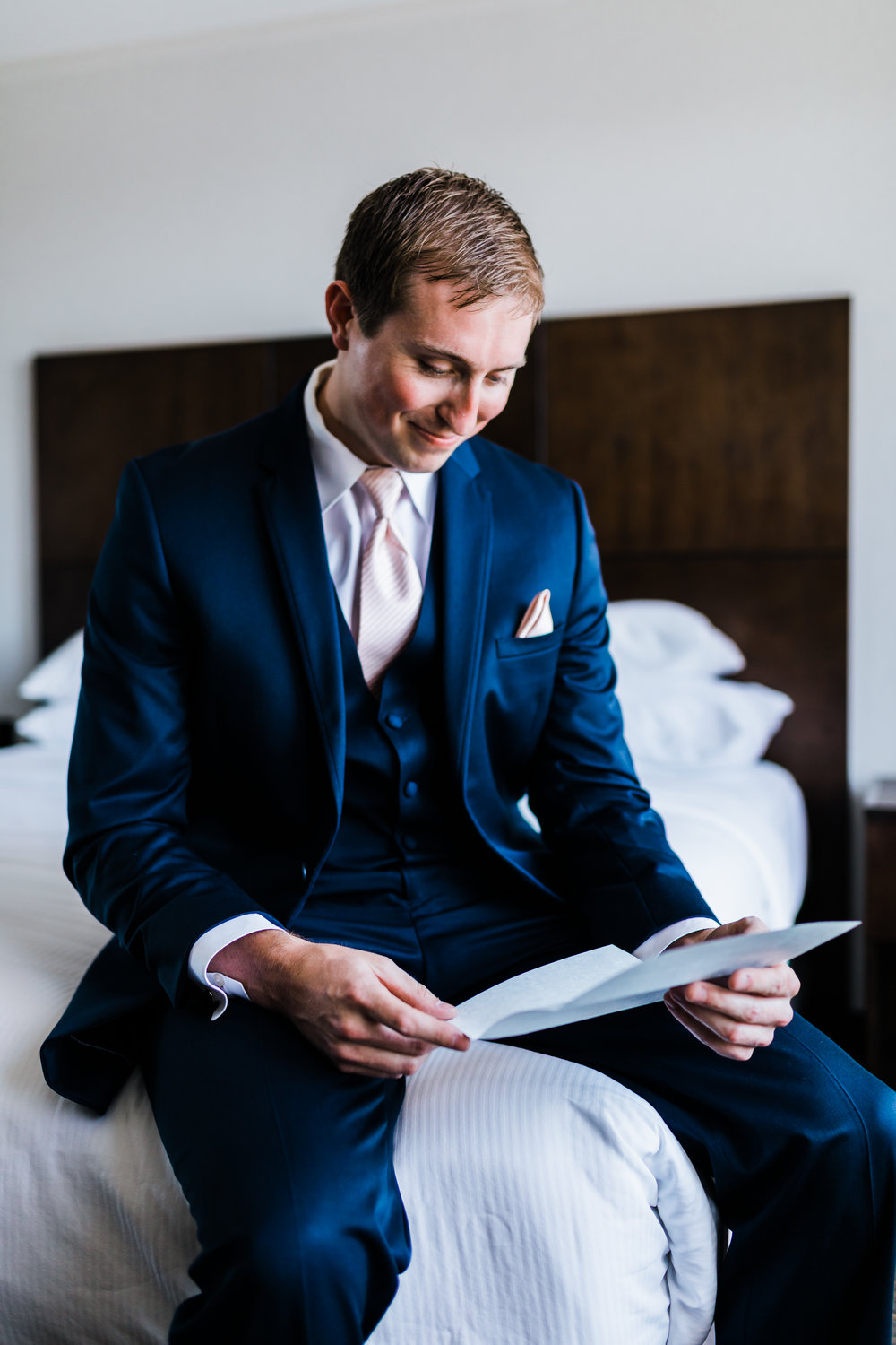 groom getting ready and reading his letter from his bride - md wedding - pasadena maryland