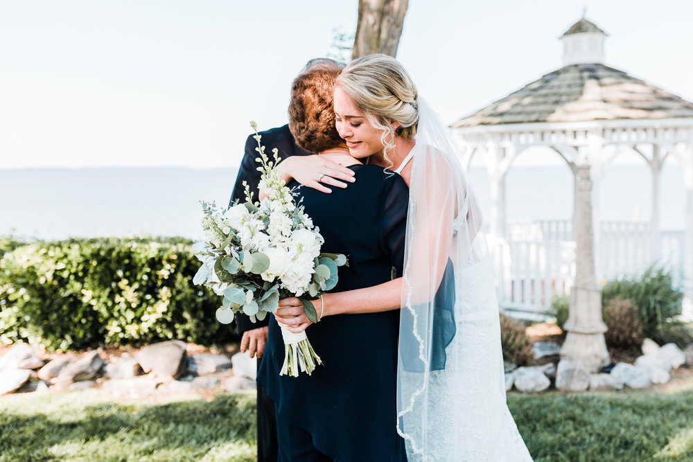 bride hugging her grandma emotionally - maryland wedding photographer