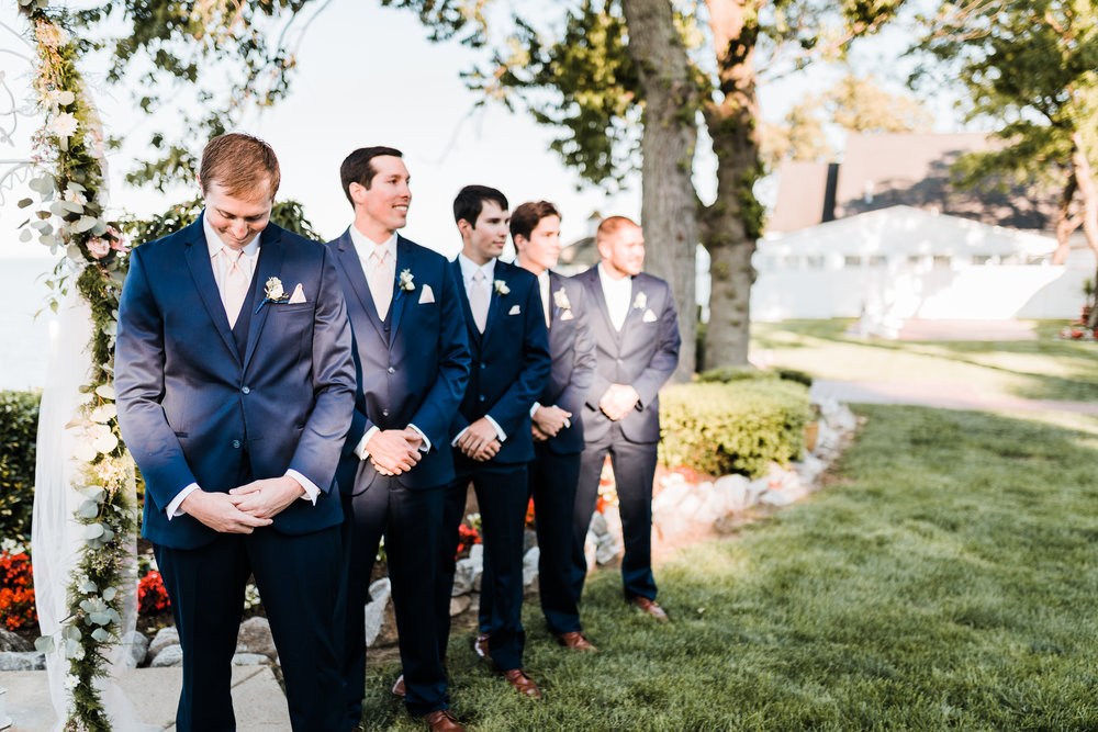 groom sees his bride walking down the aisle - groom reaction - pasadena maryland wedding photographer