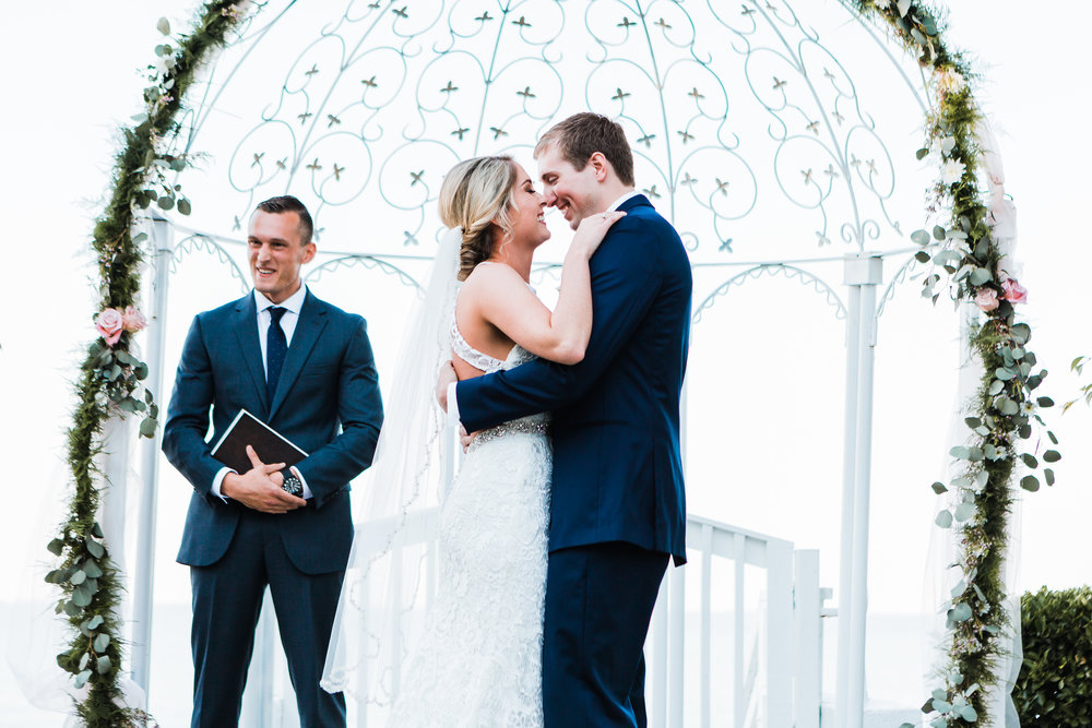 bride and groom smile at each other after their first kiss - maryland wedding photographer