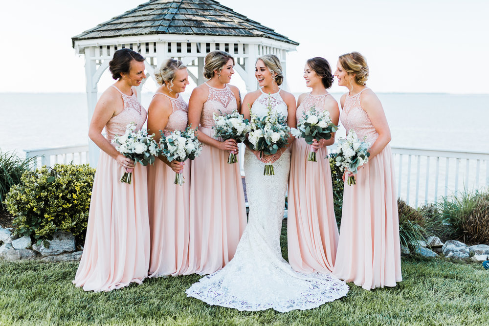 bride with her bridesmaids in light pink - high neck dresses - modern wedding - bayside - maryland