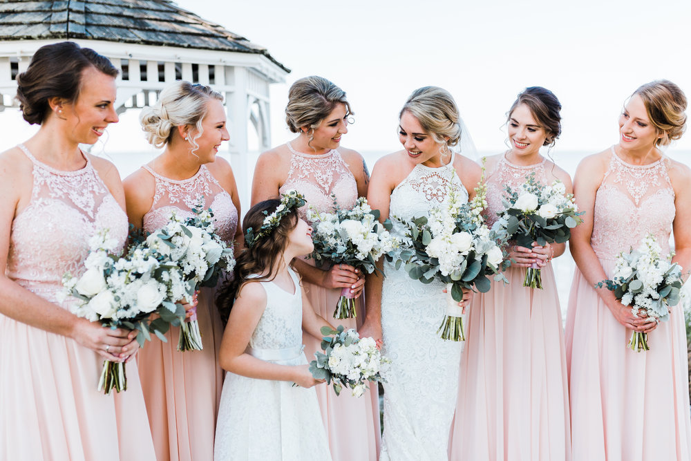 bride laughing with her bridesmaids and flower girl - celebrations at the bay - maryland wedding photographer