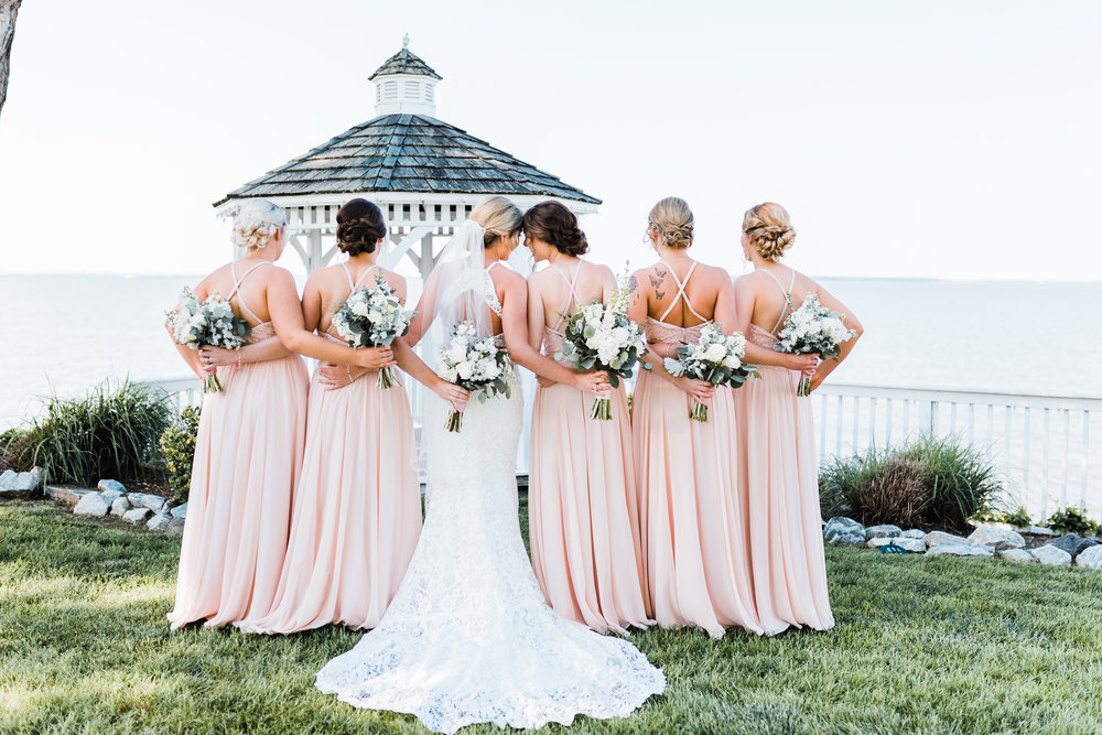 bride and her twin sister share a sweet moment - maryland wedding photographer and cinematographer