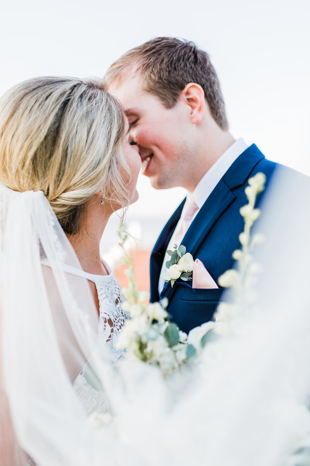 bride and groom kiss with veil wrapped around - modern wedding - maryland photographer