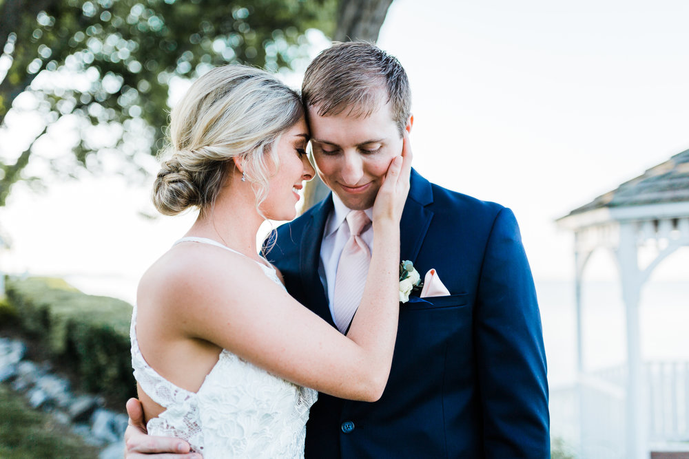 bride and groom hold each other romantically - pasadena md wedding