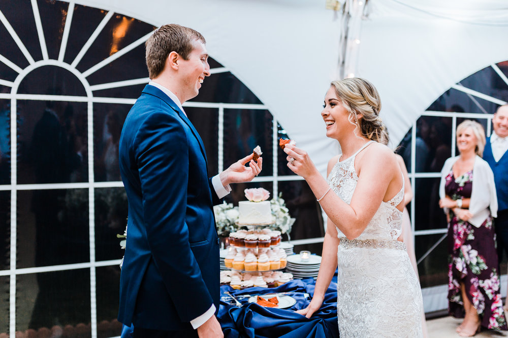 cutting the cake at celebrations at the bay - pasadena maryland wedding photographer