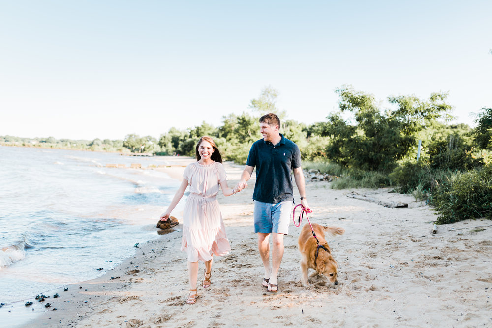 couple during their beach engagement session in pasadena md - maryland engagement photographer