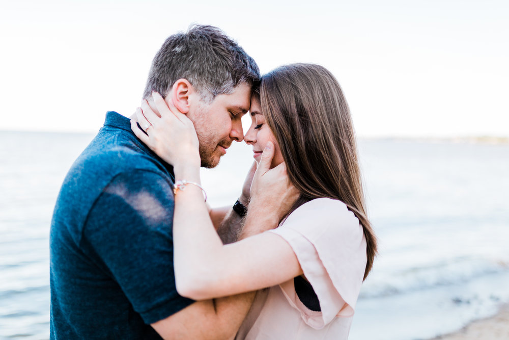 couple holds each other romantically during engagement session - maryland wedding photography - top md engagement photographer