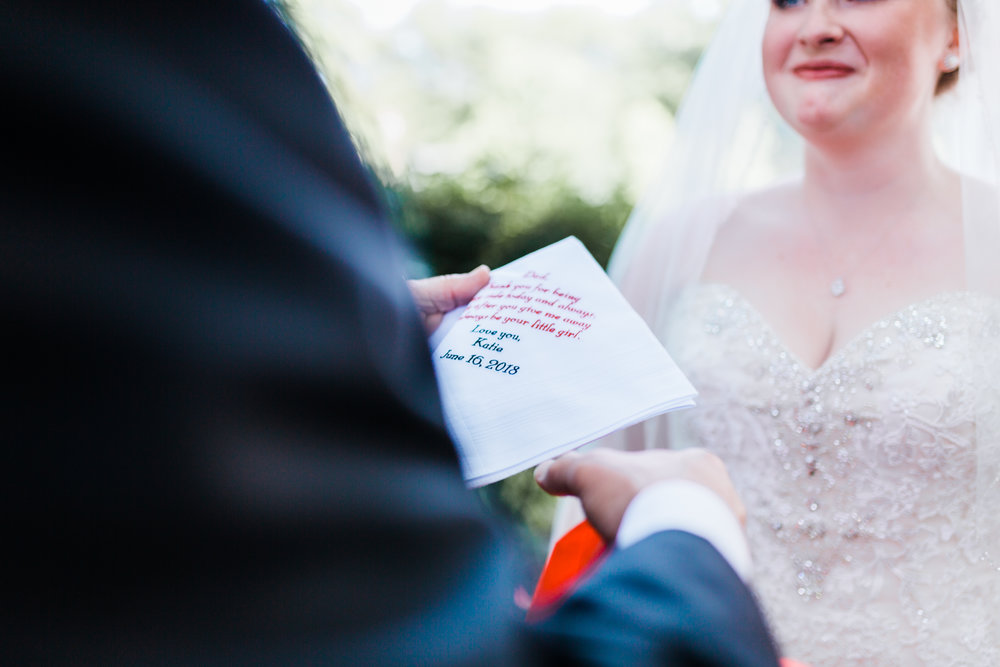 bride gives a gift to her father on her wedding day in pasadena, md - gift ideas to father of the bride - FOB - maryland wedding photographer