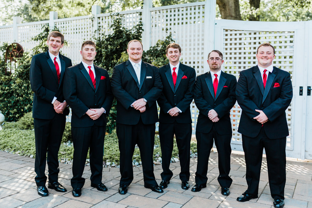 groom with his groomsmen on his pasadena, md wedding day - top maryland wedding videographer and photographer - disney inspo
