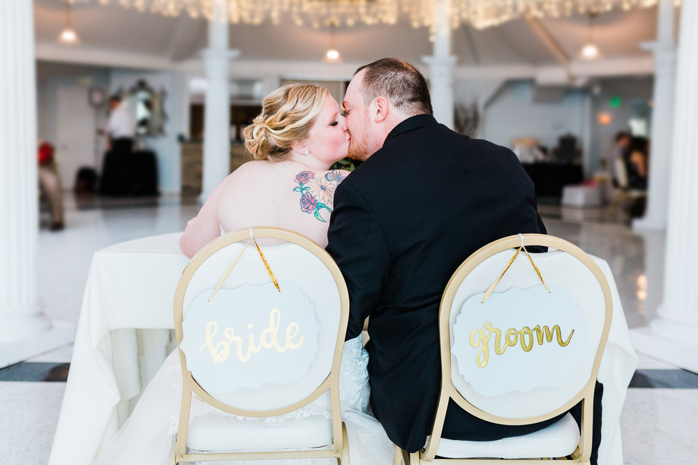 bride and groom kissing at reception - kurtz's beach pasadena, md - top maryland photographer