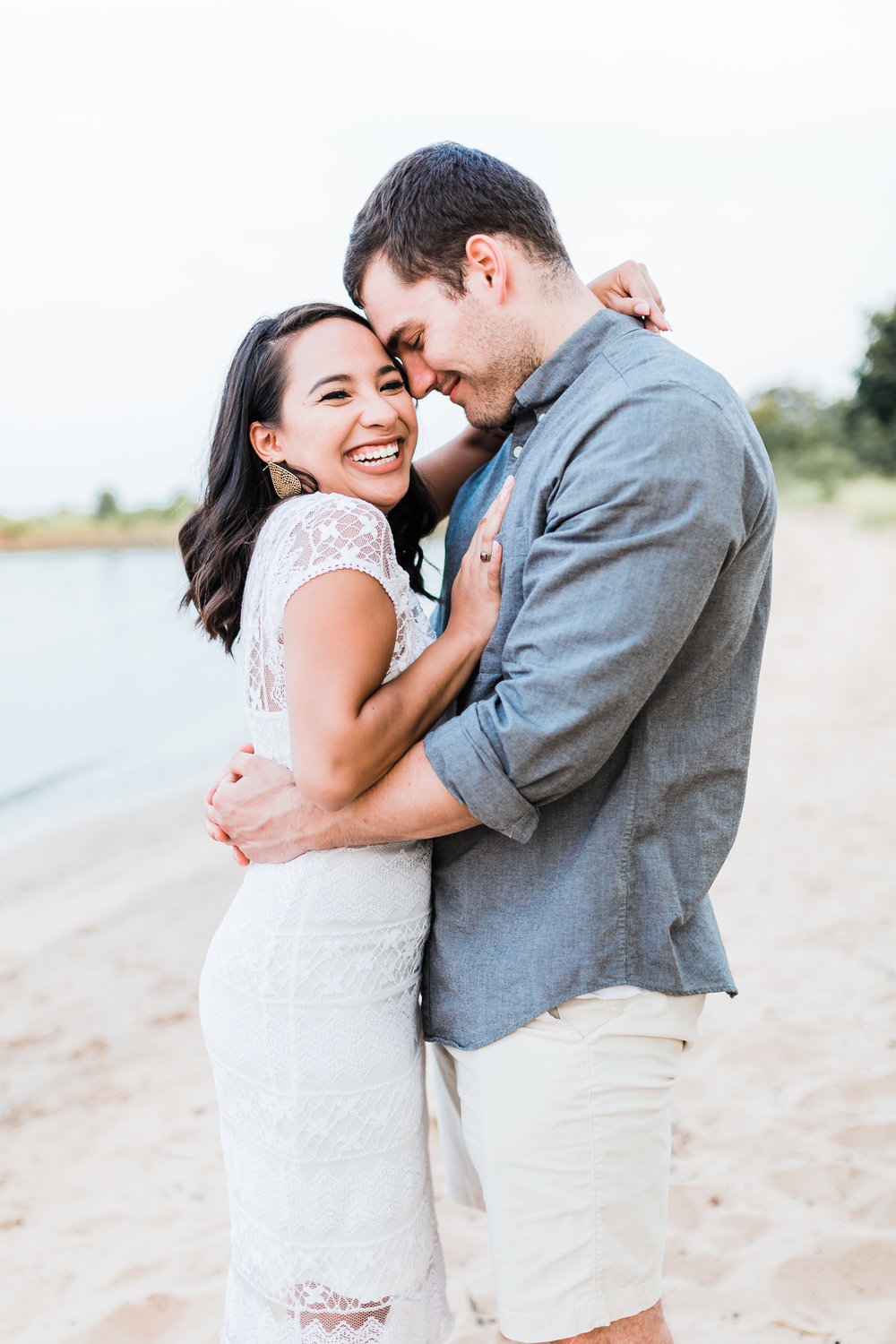 engagement photo outfit inspiration - adorable couple on the beach in maryland - top maryland engagement and wedding photographer