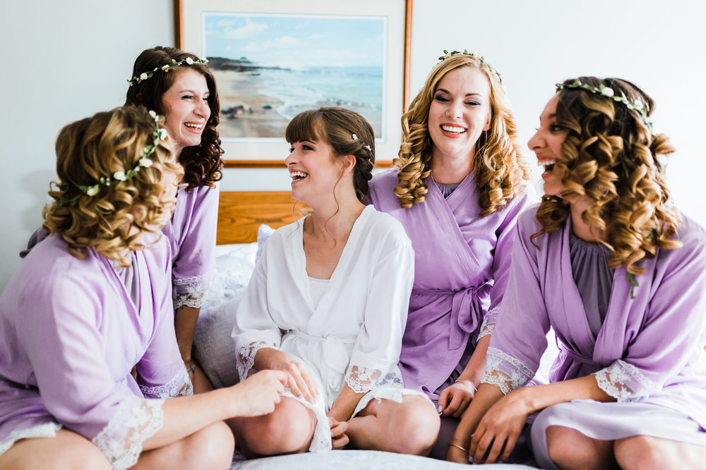 bride laughing with her bridesmaids while getting ready - md wedding photographer