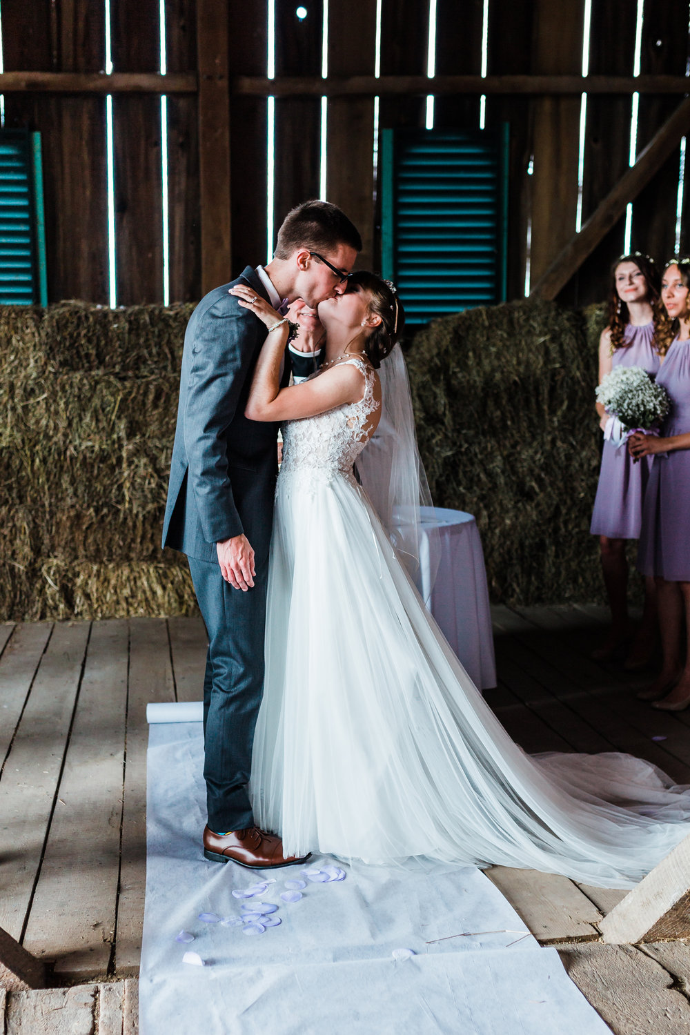 bride and groom share their first kiss as husband and wife - best rustic venues in maryland