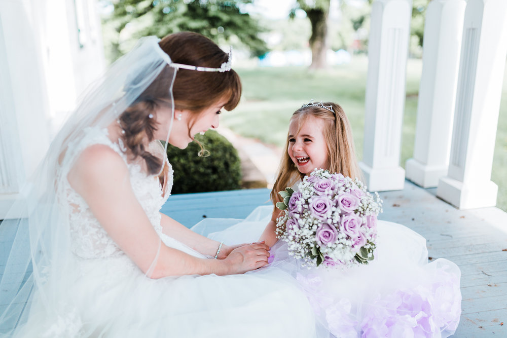 bride laughing with her flowergirl - purple wedding ideas and inspiration