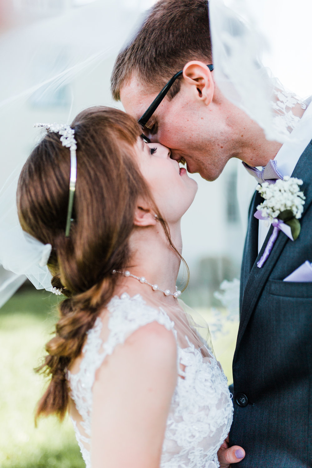bride and groom share an intimate moment under bride's veil - md wedding photographer