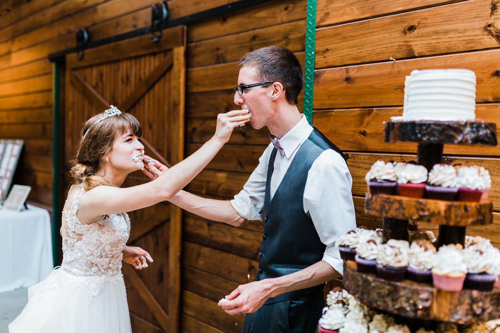 adorable cake cutting photos in maryland wedding venue
