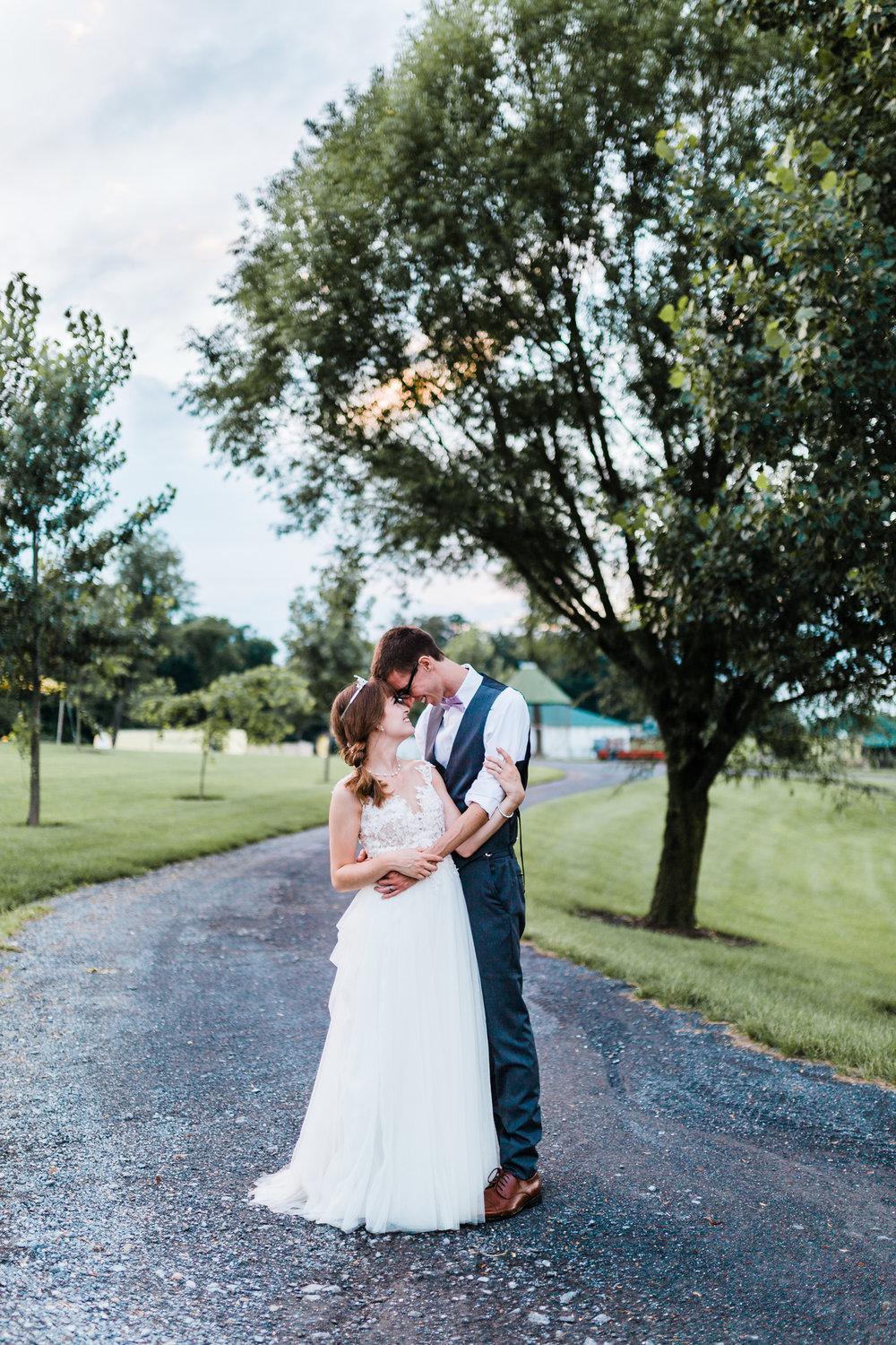 portraits of the bride and groom at golden hour - rustic maryland wedding venues